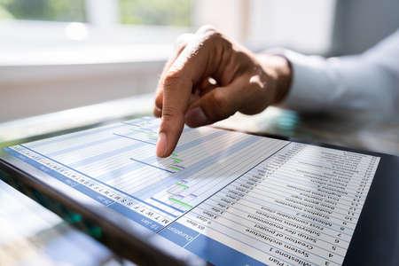 Gantt Chart On Tablet Computer. Diary Agenda Planner