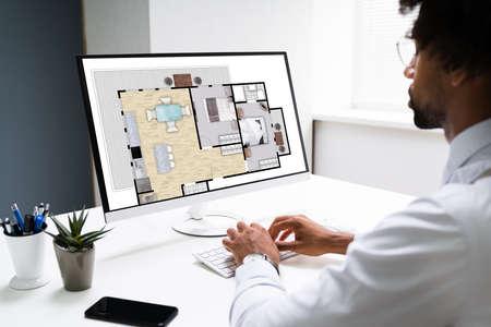 African American Home Assessor Man Using Computer