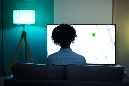 African American Streaming And Watching Movie On TV Screen