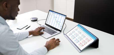 Tech Schedule List On Laptop Computer Screen. Gantt Calendar
