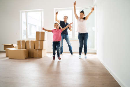 Couple Bying Home And Moving Into New House