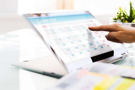 Executive Looking At Calendar Agenda On Laptop Computer