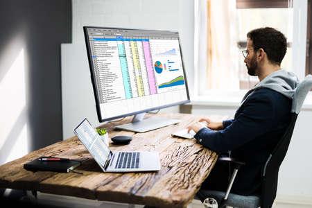 Analyst Employee Using Spreadsheet On Computer Screen