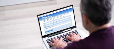 Online Survey Business Feedback Report Or Form On Computer 免版税图像