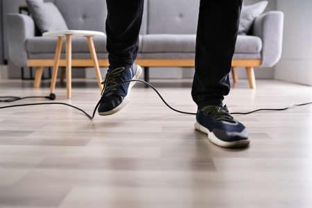 Stumble Over Cable. Clumsy Office Falldown. Insurance Compensation