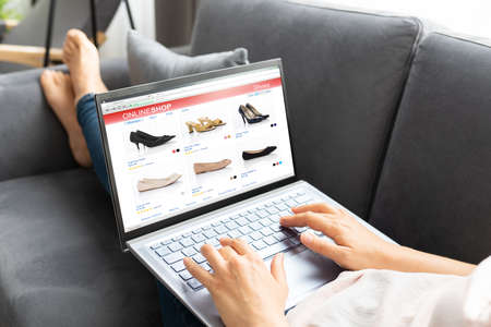 Woman Online Ecommerce Shopping Using Laptop On Sofa