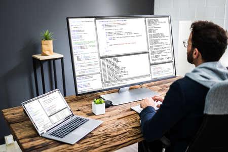 Software Developer Programmer Using Computer In Work From Office 免版税图像