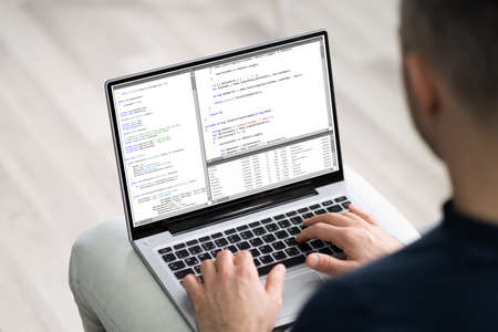 Software Developer Programmer Working On Laptop Computer