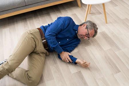 Old Senior Fallen Man. Elderly Slip And Fall Imagens