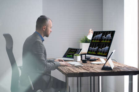 Analyst Broker Or Trader Working With Financial Data On Computer