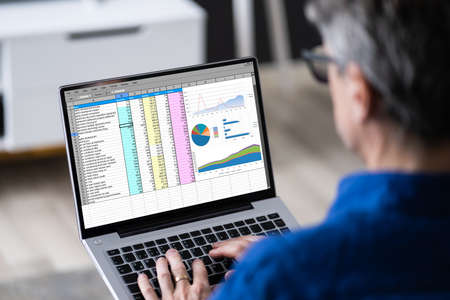Spreadsheet Data Software Reports On Laptop. Work From Home