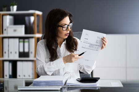 Professional Accountant Showing Sale Tax Invoice In Video Conference Call