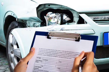 African American Car Insurance Agent Filling Accident Claim