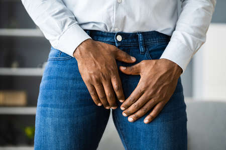 African Man Urinary Incontinence And Hurt Crotch