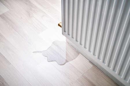 Laminate Floor Damage In Room After Heating Pipe Leakage