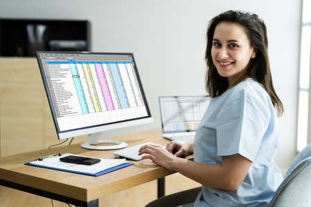 Medical Bill Codes And Spreadsheet Data. Business Analyst Woman
