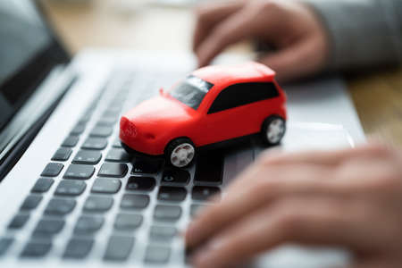 Buy Sell Online Car Insurance On Computer Фото со стока