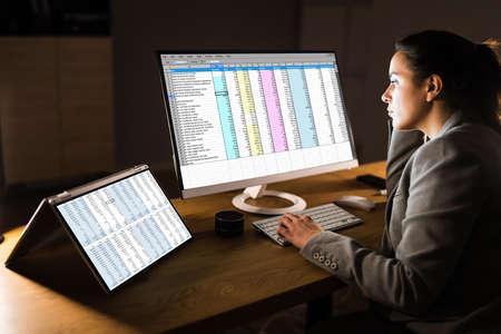 Woman Using Finance Spreadsheet Report On Laptop Screen