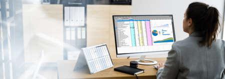 Woman Using Finance Spreadsheet Report On Laptop Screen Stock fotó