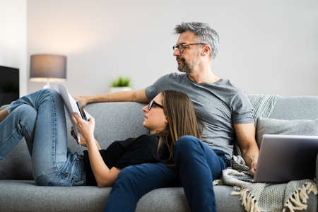 Couple Doing Taxes And Family Budget Together Stock Photo