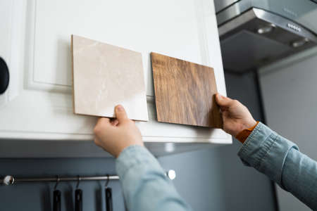 Woman Doing Kitchen Samples Interior Material Selection