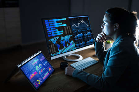 Business Woman Analyst Using KPI Data On Computer Stock Photo