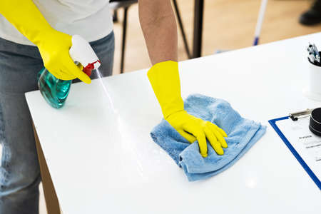 Janitor Cleaner Woman In Face Mask Cleaning Desk