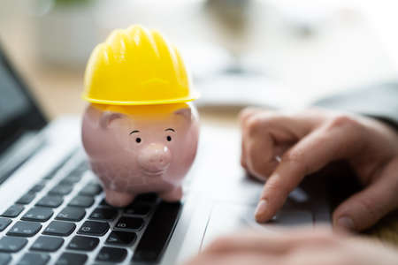 Piggy Bank With Hard Hat Or Safety Construction Security