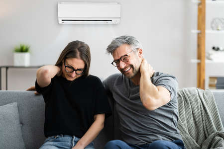 Air Conditioner Couple Sneezing And Having Sore Neck