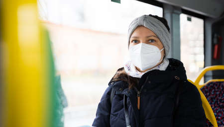 Woman In Public Bus Transport With FFP2 Face Mask