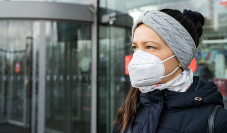 Woman Traveling Using Public Transport In Face Mask