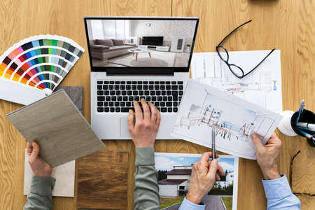 House Designer And Decorators Using Computer For Design Stock Photo