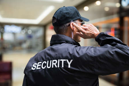 Mall Or Retail Store Security Guard Officer Stock Photo