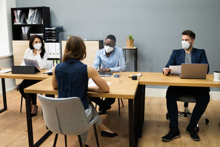 Business Manager Job Interview Talking In Face Mask