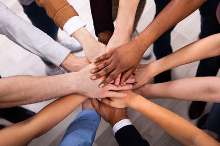 High Angle View Of Multiracial Friend Stacking Hand Together Banco de Imagens