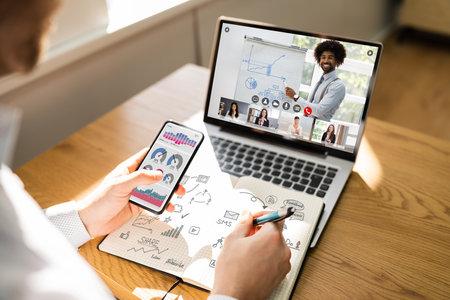 Virtual Online Training Program With Coach On Laptop Stock Photo