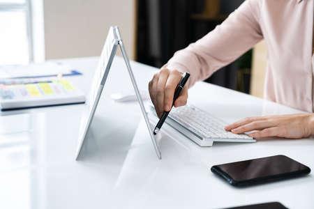 Graphic Designer Artist Drawing On Digital Tablet Or Hybrid Laptop