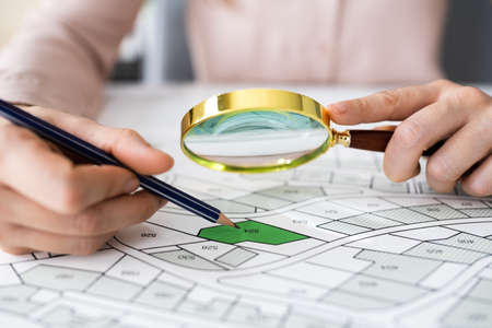 Glass Over Land Map Planning And Development Paper Standard-Bild