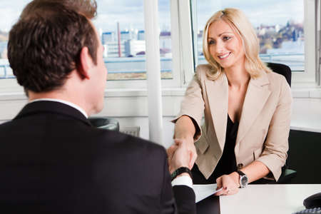Two businesspeople at an interview in the office