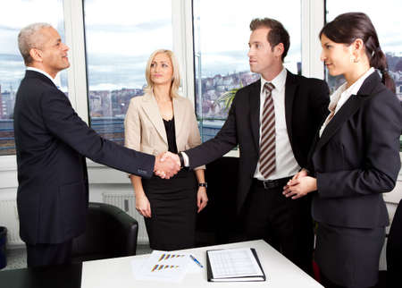 Business handshake over the deal at office