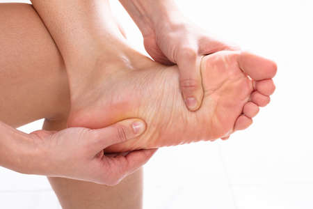 Young Woman Having Feet Massage At Home