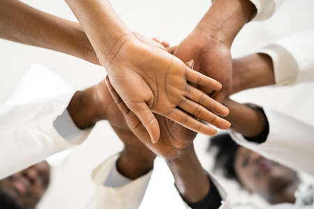 African American Medical Team Staff Hands Stack