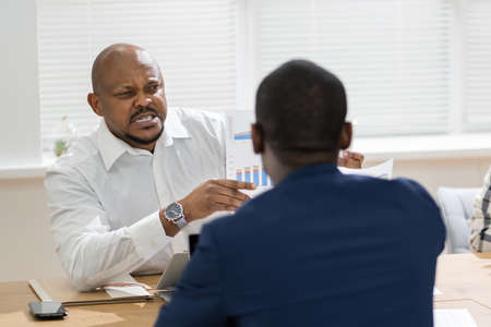 African Boss Shouting At Workplace. Conflict And Stress In Office