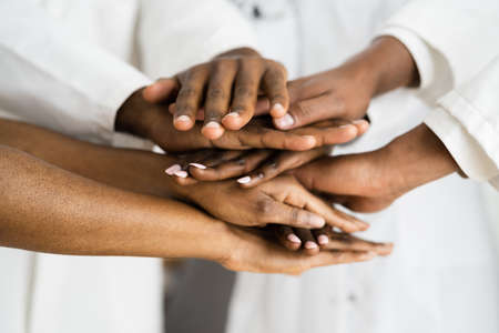 African American Medical Team Staff Hands Stack Stock Photo