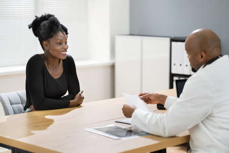 African American Patient At Medical Doctor Office