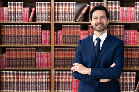 Male Attorney With Arms Crossed. Lawyer In Office Stock Photo