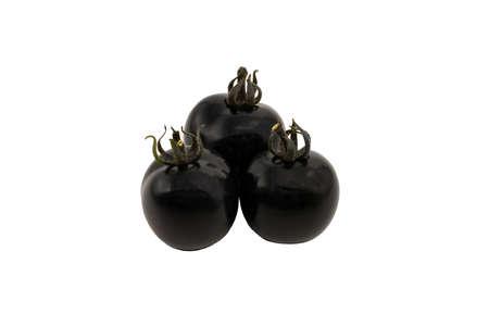 Black tomatoes close-up isolated on white background