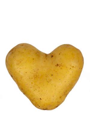 Heart shaped potato close-up isolate on white background