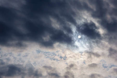 Cloudy weather, the sun through the clouds, gloomy depressive background