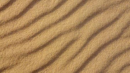 Brown wavy sand texture close up, beautiful natural natural background